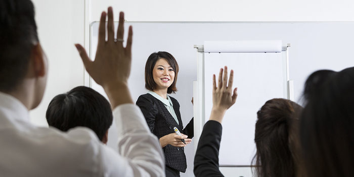 asian woman teaching class
